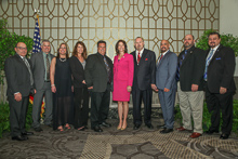 Rep. Cheri Bustos (D-IL 17th), fifth from right, with, l. to r., IVP-NE John Fultz; John Tortat, L-60; guest Julie Tortat; guest Debbie Cooper; Kirk Cooper, L-60; IR Bill Staggs; IR Miguel Fonseca; ED-QCCUS/AD-CSO Eugene Forkin III; and IVP-WS J. Tom Baca.