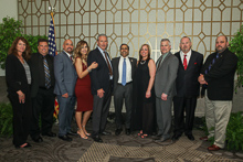 Rep. Raja Krishnamoorthi (D-IL 8th), fifth from right, with l. to r., guest Debbie Cooper; Kirk Cooper, L-60; IR Miguel Fonseca; guest Lisette Fonseca, IVP-GL Larry McManamon; guest Julie Tortat; John Tortat, L-60; AD-ISO Bill Staggs; and ED-QCCUS/AD-CSO Eugene Forkin III.