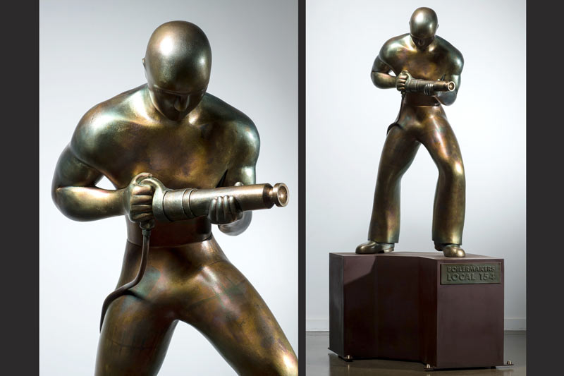 A completed bronze Riveter, designed by artist Charles Jones, stands on a custom designed and built base.