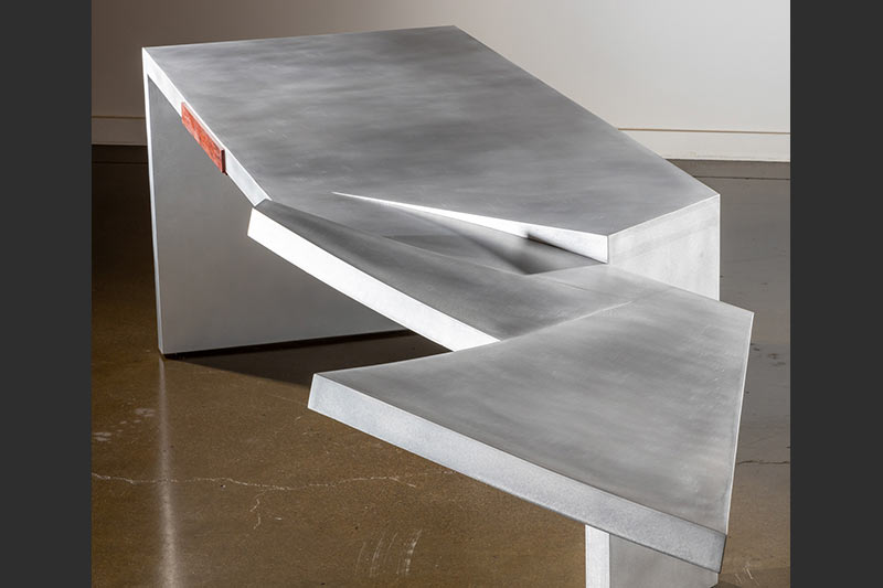 Charles Jones designed and built a torn-form aluminum table for the 2019 PowerGen conference held in New Orleans, LA.