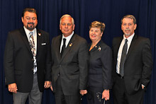 Rep. Gene Green (D-TX 29th), second from left, with IVP J. Tom Baca, Helen Green, and Mark Thompson, Local 132.