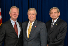 West Virginia Auditor Glen Gainer III, center, with IP Newton Jones, left, and B.B. Smith, Local 667 (retired).