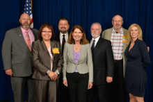 Rep. Ann Kirkpatrick (D-AZ-1st), center, with l. to r., D-CRS Gary Evenson; Celia Lowrey, L-627; IVP J. Tom Baca; IST Bill Creeden; ED-CSO Kyle Evenson; and D-PA Bridget Martin.