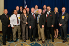 Rep. Ron Barber (D-AZ-2nd), fifth from left, with International officers, International staff, and local lodge delegates. L. to r., front row, Tyson Tullie, L-4; Louis Dodson, L-4; Celia Lowrey, L- 627; IP Newton Jones; IVP J. Tom Baca; D-PA Bridget Martin; and Wes Hevener, L-627. Back row, l. to r., Jacob Evenson, L-627; Gary Aycock, L-627; IST Bill Creeden; ED-CSO Kyle Evenson; and D-CRS Gary Evenson.