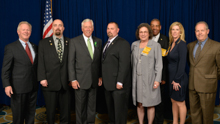 House Democratic Whip Steny Hoyer, third from left, and l. to r., IP Newton Jones; Mike Herd, L-193; Dan Weber, L-193; Alonna Morris, L-S50; Hudson Hart, L-S50; Bridget Martin, D-PA; and retired L-193 BM-ST Ernie Dorsey.