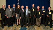 Rep. Sandy Levin, (D-MI-9th), sixth from left, with the L-169 delegation and IP Newton Jones, fifth from left; IVP Larry McManamon, third from left; IR Len Gunderson, third from right; and IR Don Hamric, far right.