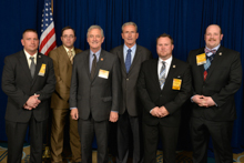 Rep. Rick Nolan (D-MN-8th), third from left, with IVP Larry McManamon, fourth from left; and l. to r., L-647 delegates Matt Olsen, Stacey Bendish, Derek McPheeters, and Keenan Retterath.