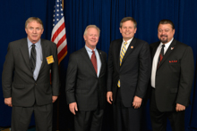 Rep. Steve Daines, third from left, with l. to r., John Roeber, L-11; IP Newton Jones; and IVP J. Tom Baca.