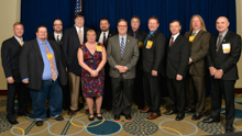 Rep. Denny Heck (D-Wash-10th), center front, with IVP J. Tom Baca, sixth from left, Gary Powers, AD-ISO, far left; and delegates from the state of Washington.