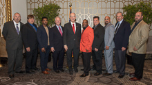 Rep. Bill Foster (D-IL 11th), fifth from left, with, l. to r., IR Bill Staggs; Gary Lusk, L-60; Eli Matthews, L-1247; IP Newton Jones; James Young, L-1247; Kirk Cooper, L-60; IR Miguel Fonseca; IVP Larry McManamon; and ED-QCCUS/AD-CSO Eugene Forkin.