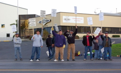 Members or Local 599 (Billings, Mont.) walk the picket line during the lodge's 11-day strike against Beall Trailers of Montana.