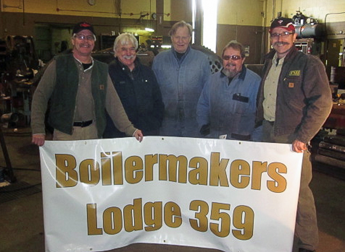 showing their pride in restoring the steam donkey are l to r bill rogers mike roxburgh barry pyne barry dobrensky and jorge vidal