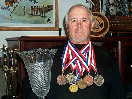 L-154's John Heine-Parisi shows some of the medals he has won over his 40-year skydiving career.