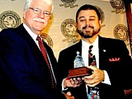 Rep. George Miller, l., accepts the 2007 Legislator of the Year award from IVP Tom Baca.