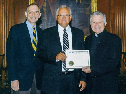 Bruce Scott, center, receives a certificate commemorating his prayer from Rep. Visclosky left, and Rev. Daniel P. Coughlin, Chaplain of the House of Representatives, right.