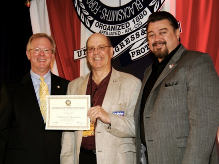 L-11 President Robert Winger (c.) receives an award from IP Newton Jones, left, with IVP J. Tom Baca at right.