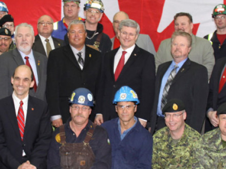 Canadian Prime Minister Stephen Harper (center with glasses and red tie), joins