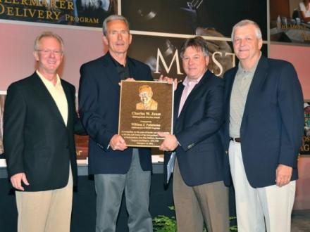 MOST ADMINISTRATOR BILL PALMISANO, r., receives the Charles W. Jones Distinguish