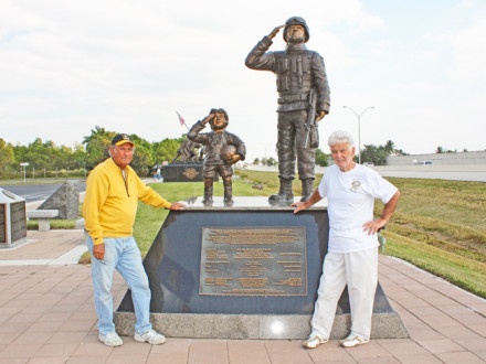 L-237 retiree Rudy Diaz, right, and partner Danny Pardo stand before the statue they created for display in Cape Coral, Fla.