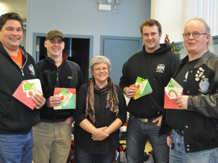 L-359 members present gift cards to Patti Larson, representing the Christmas hamper in Revelstoke, British Columbia. Left to right, J'onn Giese, Rick McIssac, Larson, Adam Saunders, and Jim Wymer.