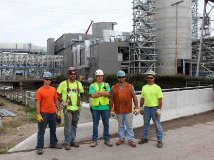Local 169 members (l-r) Branden Dormire, Chris Larose, Kevin Mackenzie, Ben Ryers and Brian Smith pause near the lime prep and byproducts disposal area, part of the new spray dry absorber system. Photos by Marty Mulcahy, The Building Tradesman