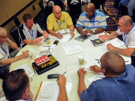 Members practice handling a grievance during a breakout session led by Ruth Needleman of the National Labor College.