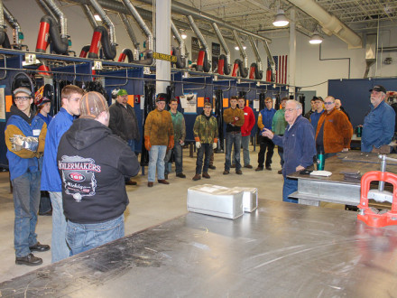 Retired L-169 instructor Jim Howard addresses participants in the lodge's annual welding contest for high school students.