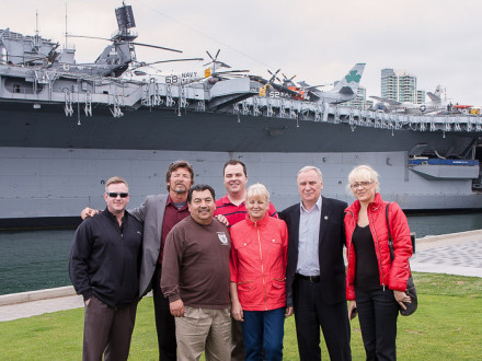 Ukrainian visitors to L-1998 enjoy a close-up view of the USS Midway aircraft carrier. Left to right, Gary Powers, A/D-ISO; Jim Cooksey, IR; Bobby Godinez, L-1998 president; Tyler Brown, D-ISO/AAIP; Liubov Nyemov; Anatoliy Nyemov, chairman of the Okean Shipyard trade union; and Oksana Kovalka, interpreter.