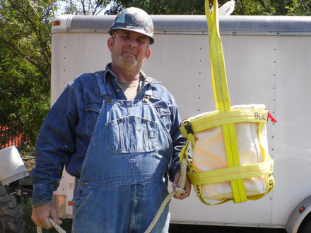 Chris Still demonstrates his safety sling with a canvas bag insert.
