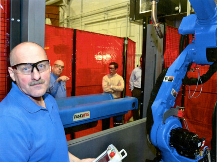 Ed Warner checks out a new robotic weld cell.