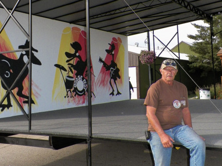 Melvin Wappula takes a seat on the stage he designed and helped build for his home town.