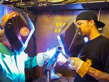 Engineer graduate Alicia Crass, Kiewit, receives welding instruction from L-83 apprentice Steve Ryken.