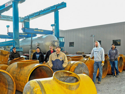 L-84 officers and stewards stand among slug catcher manifold sections in the loading yard. L. to r., Brent Mitzner, president; Philip Slater, steward; Doug Damron, secretary-treasurer; Bob Wheeler, recording secretary; Nathan Eichorn, steward; and Jeremy Wright, steward. Not pictured are Brian Haight, vice president, and Josh Dilliner, inspector.