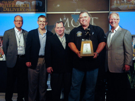 L-433 BM-ST James Barnes, second from right, accepts the C.W. Jones Award on behalf of the lodge. Left to right are MOST Administrator Roger Erickson, NACBE President Eric Heuser, IVP-SE Warren Fairley, Barnes, and IP Newton Jones.