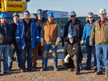 Members attend the first Canadian Master Rigger Course. Left to right, Jim Beauchamp, National Training Program coordinator/instructor; Kyle Howard; Bruce Callihoo; Gabriel Gauthier; Grant Kostner; Ross Gartner (crouching); John Wells, crane operator; Fred Wright; and Russell Reid, Local 146 instructor.