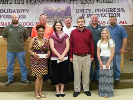 L-83 (KANSAS CITY) SCHOLARSHIP WINNERS are pictured with the lodge's scholarship committee. Front row, l. to r., Taylor Ashley, daughter of Todd Ashley; Miranda Helmich, daughter of Bill Helmich; Bruce Smith, Jr., son of Bruce Smith; Tristin Reed , daughter of Sam Reed; back row, l. to r., Scot Albertson, Business Agent; Joe Lewandowski, BM-ST; John Seward, Shop Representative; Scott Campbell, President/ Business Agent; and Tom Dye, Vice President /Business Agent. Not pictured: Danielle Phipps, daughter of