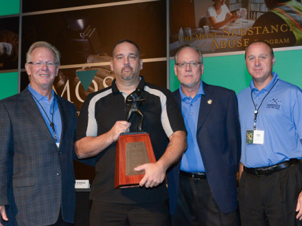 BOSTON LOCAL 29 BM-ST CHARLES HANCOCK accepts the Charles W. Jones Award on behalf of his lodge. L. to r., IP Newton Jones, Hancock, MOST Administrator Roger Erickson, and MOST Chairman Greg Purdon.