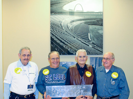 Former Boilermakers who helped build the Gateway Arch stand with a remnant of the actual stainless steel used in fabricating the monument sections. The men were on hand to celebrate Arch Builders Day in St. Louis Oct. 28.  Left to right, Ken Wright, Donald Chambers, Ike Erdman and Archie Brittain.  Walt Atwood photo