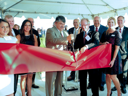 AFL-CIO President Richard Trumka, with scissors, and Bank of Labor (BOL) Chairman and CEO Newton Jones, standing with Trumka, cut the ribbon to officially open the bank's new Washington, D.C., office. Joining in the ceremony are, l. to r., Megan Elder, BOL Marketing Development Officer; Bob McCall, BOL President; Puja Arora, COO, AFL-CIO ITC; Jack Marco, Chairman, Marco Consulting Group (partially hidden); Patrick Finley, General President, OPCMIA; Ed Smith, CEO, Ullico; Bridget Martin, BOL Market President