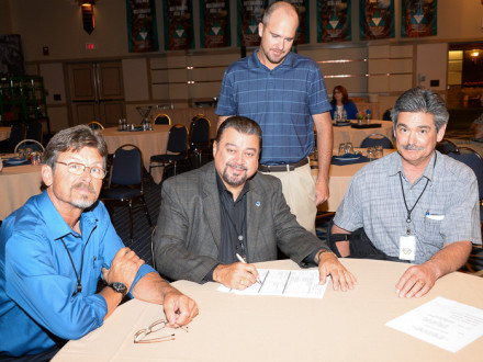 Signing real estate documents for a new training center to be built in Salt Lake City are, l. to. r., Jim Cooksey, AIP/IR-CSO, WSJAC Trustee; J. Tom Baca, IVP-WS, WSJAC Secretary; Collin Keisling, WSJAC Coordinator; and Larry Jansen, ARB Vice President and WSJAC Chairman.