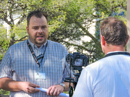 Tyler Brown, COS/ED-ISO, gives an interview during a global cement conference in Hyeres, France, Oct. 17-19.