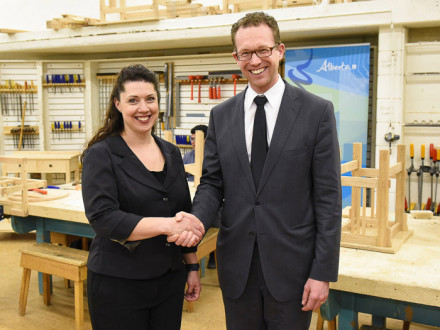 Alberta Minister of Advanced Education Marlin Schmidt congratulates L-146 member j'Amey Holroyd upon her appointment as AIT board chair.