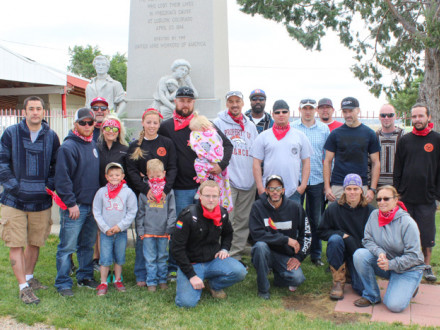 Attending the memorial service are, l. to r. (standing), Robert Gallegos, Justin and Tessie Triplett, BM-ST Tim Ruth, Brandon and Tiffany Turner and family, Sharif Carter, Jesse Hopkins, Dave Uhl, Nikolay Lyubimenko, Lorenzo Tonche, Craig Rose, John Matusky and Josh Mayes; (kneeling) James Breckenridge, Twayne Decuir, James Gardner and Stacey Uhl. Not pictured are Brian Rose and Rosario Obilisundar.