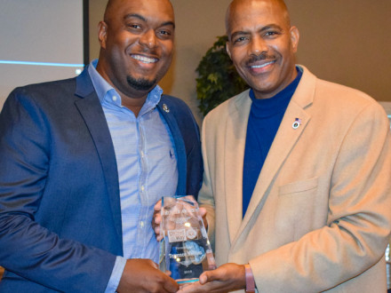 Local 693's Terrence Nellum, left, receives the Hustle Award from Tee McCovey, public relations director for the Mississippi United Way for Jackson and George Counties.