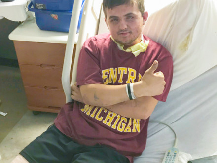 Local 169 apprentice Patrick Morand gives a thumbs-up after being hospitalized.