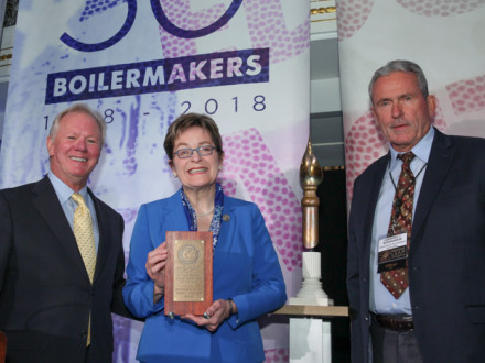 Rep. Marcy Kaptur accepts the Boilermakers' top legislator award for a member of the U.S. House. L. to r., IP Newton Jones, Rep. Kaptur and IVP-GL Larry McManamon.