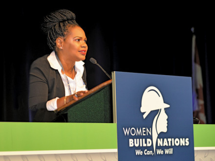 IR Erica Stewart helps emcee the plenary sessions at Women Build Nations.
