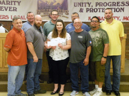 Pictured at left back row, l. to r.: Inspector John Seward, Recording Secretary Zach Hayes, and Iowa Rep Tom Dye. Front row, l. to r.: President Robbie Gant, BM-ST Scot Albertson, scholarship recipient Samantha Hicks, Kenneth Hicks, Trustee Dave Delgado and Trustee Danny Eastwood.