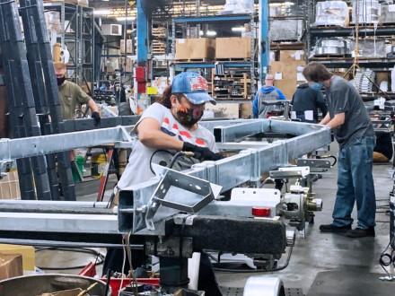 Boilermakers Maria Zuniga and Thomas Kinn assemble a trailer frame.