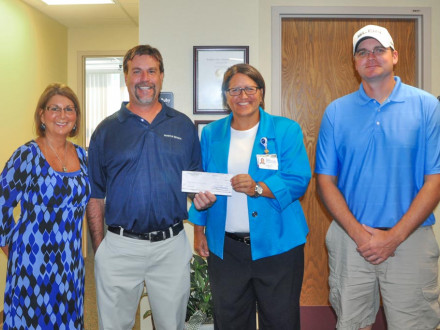 Local 105 Boilermakers present a check to the Southern Ohio Medical Center Hospice in 2016, as they do every year after their charity golf scramble. From left: Sheila Riggs, Southern Ohio Medical Center Hospice; Scott Hammond, BM-ST, Local 105 (Piketon, Ohio); Teresa Ruby, SOMC Hospice; and Joe Ledford, chairman of the golf committee for L-105.